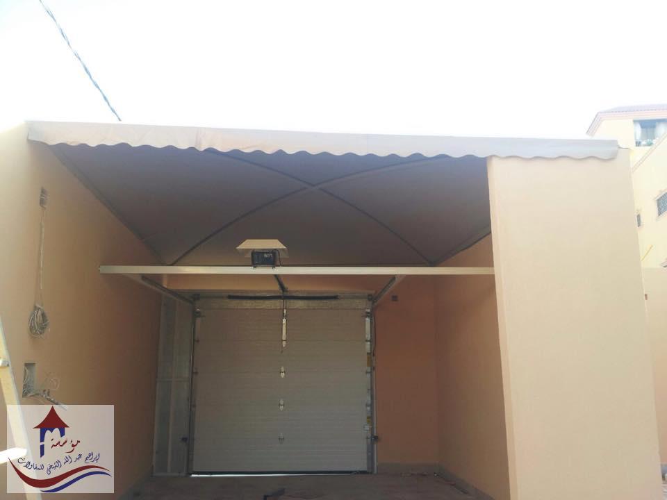 مظلات مقص لبوابة المنزل